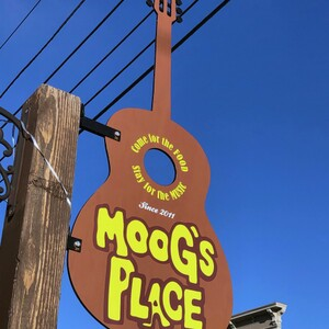 guitar sign for moog's place