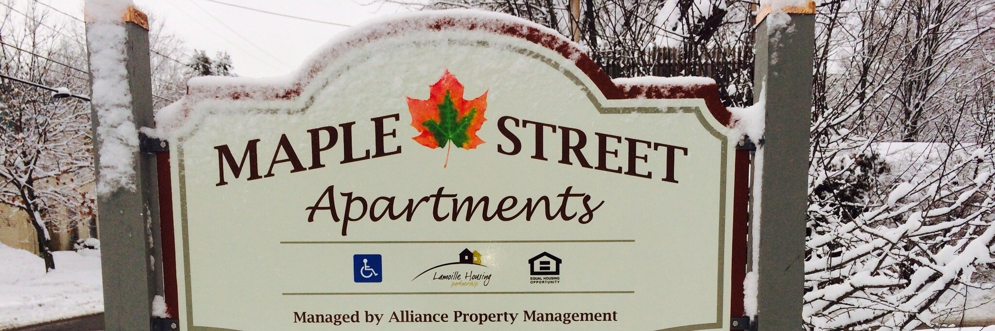 maple street apartments sign